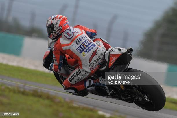 Ducati Team's Italian rider Andrea Dovizioso takes a corner during the last day of 2017 MotoGP preseason test at the Sepang International Circuit on...