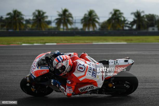 TOPSHOT Ducati Team's Italian rider Andrea Dovizioso takes a corner during the last day of 2017 MotoGP preseason test at the Sepang International...