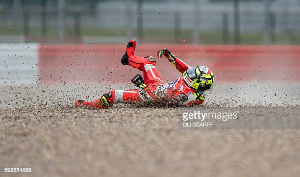 TOPSHOT Ducati Team's Italian rider Andrea Iannone crashes on the Farm Curve corner during the third MotoGP Free Practice session at the motorcycling...