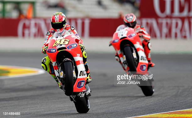 Ducati Team's Italian Valentino Rossi and Ducati Team's US Nicky Hayden ride during MotoGP's third practice session of Valencia's MotoGP Grand Prix...