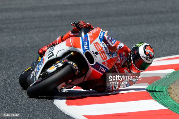 Ducati Team's Spanish rider Jorge Lorenzo competes during the MotoGP qualifying session of the Moto Grand Prix de Catalunya at the Circuit de...