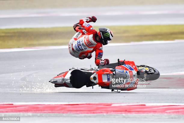 TOPSHOT Ducati Team's Spanish rider Jorge Lorenzo falls from his bike during the San Marino Moto GP Grand Prix at the Marco Simoncelli Circuit in...
