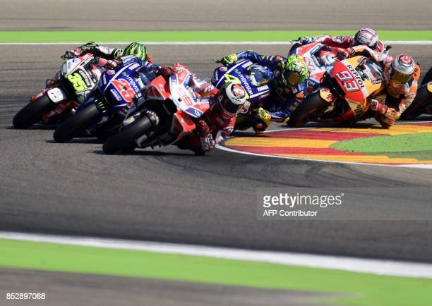 TOPSHOT Ducati Team's Spanish rider Jorge Lorenzo leads the group after the start of the MotoGP race of the Moto Grand Prix of Aragon at the...