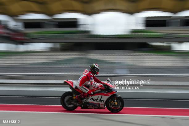 TOPSHOT Ducati Team's Spanish rider Jorge Lorenzo leaves the pit lane during the second day of the 2017 MotoGP preseason test at the Sepang...