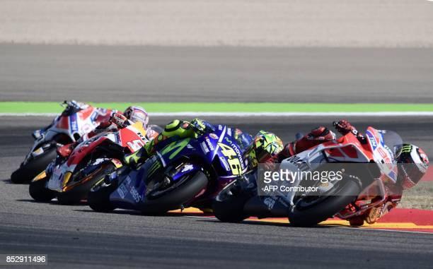 Ducati Team's Spanish rider Jorge Lorenzo Movistar Yamaha MotoGP's Italian rider Valentino Rossi and Repsol Honda Team's Spanish rider Marc Marquez...