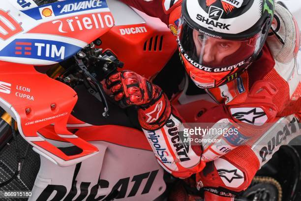 TOPSHOT Ducati Team's Spanish rider Jorge Lorenzo negotiates a corner during the second practice session of the Malaysia MotoGP at the Sepang...
