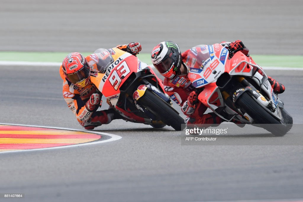Ducati Team's Spanish rider Jorge Lorenzo (R) rides ahead of Repsol Honda Team's Spanish rider Marc Marquez during the Moto GP second free pratice of the Moto Grand Prix of Aragon at the Motorland circuit in Alcaniz on September 22, 2017. /