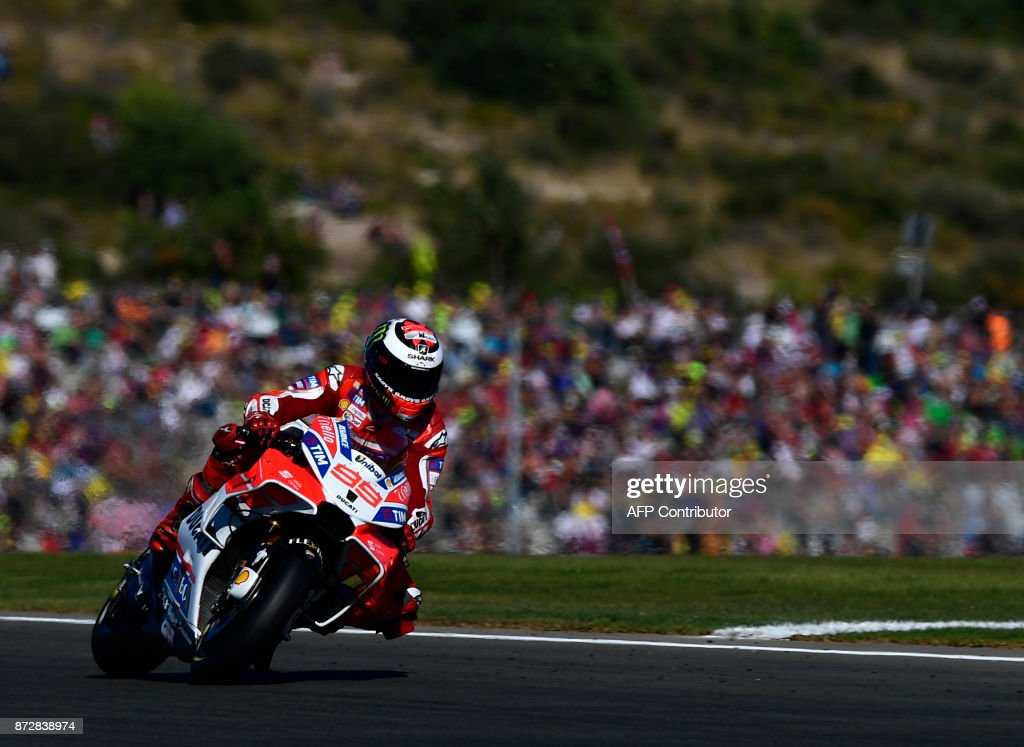 Ducati Team's Spanish rider Jorge Lorenzo rides during the fourth MotoGP free practice session of the Valencia Grand Prix at Ricardo Tormo racetrack in Cheste, near Valencia on November 11, 2017. /