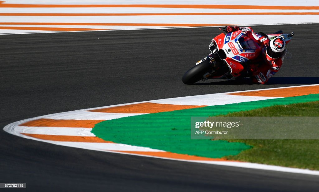 Ducati Team's Spanish rider Jorge Lorenzo rides during the third MotoGP free practice session of the Valencia Grand Prix at Ricardo Termo racetrack in Cheste, near Valencia on November 11, 2017. /