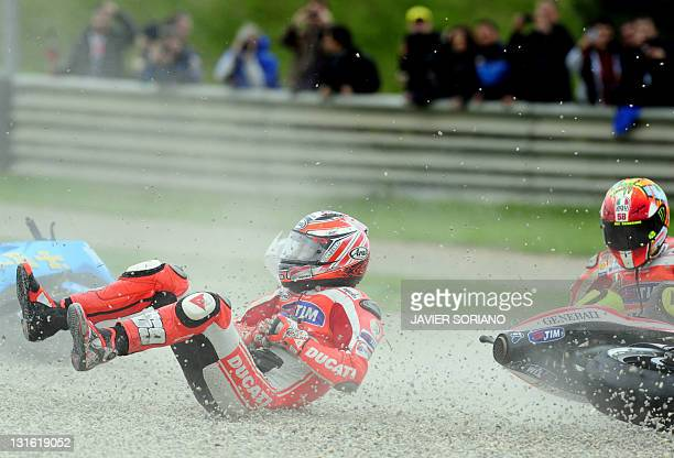 Ducati Team's US Nicky Hayden and Ducati Team's Italian Valentino Rossi fall during the MotoGP race of Valencia's Grand Prix at Ricardo Tormo...