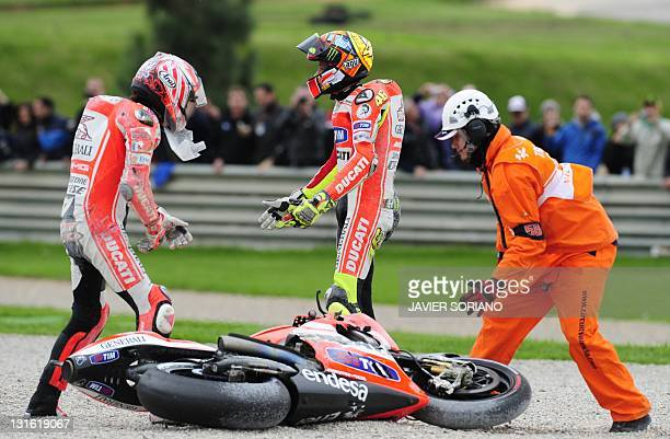 Ducati Team's US Nicky Hayden and Ducati Team's Italian Valentino Rossi stand after falling during the MotoGP race of Valencia's Grand Prix at...