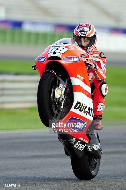 Ducati Team's US Nicky Hayden makes a wheelie during MotoGP's first practice session of Valencia's MotoGP Grand Prix at Ricardo Tormo race track in...