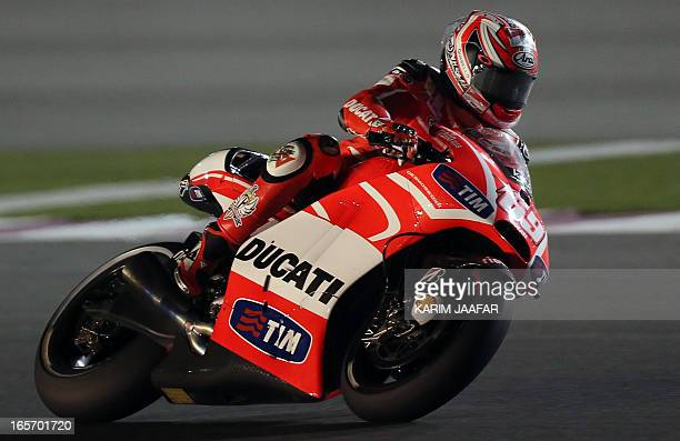 Ducati's American rider Nicky Hayden drives during a free practice for the Qatar Grand Prix at the International Circuit in the Qatari capital Doha...