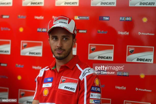 Ducati's Italian rider Andrea Dovizioso walks outside the team hospitality box in the paddock on the eve of the Malaysia MotoGP's first practice...