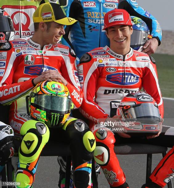 Ducati's MotoGP rider Valentino Rossi of Italy and his teammate Nicky Hayden of the US share a laugh during the official photoshoot at the Losail...