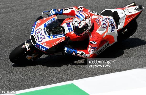 Ducati's rider Italian Andrea Dovizioso competes during the Moto GP free practice session of the Italian Grand Prix at the Mugello track on June 2...