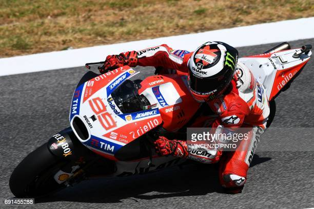 Ducati's rider Jorge Lorenzo competes during the Moto GP free practice session of the Italian Grand Prix at the Mugello track on June 2 2017 / AFP...