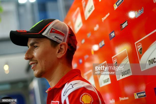 Ducati's Spanish rider Jorge Lorenzo talks to the media outside the team hospitality box in the paddock on the eve of the Malaysia MotoGP's first...