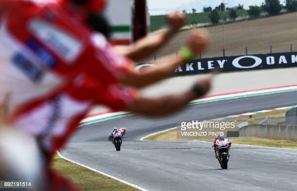 Ducati's team member cheer their rider Italian Andrea Dovizioso who won the Moto GP Grand Prix at the Mugello race track on June 4 2017 Ducati's...