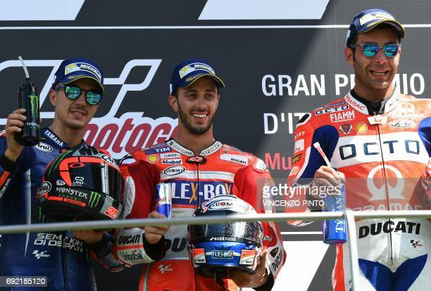 Ducati's Team rider Italian Andrea Dovizioso winner poses with Movistar Yamaha's Spanish rider Maverick Vinales second and OCTO Pramac Yakhnich's...