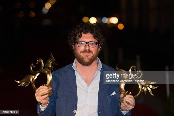 Duccio Chiarini poses with his prize as he was awarded for Special Jury Award and young people Award during the closing Ceremony of the 29th Cabourg...