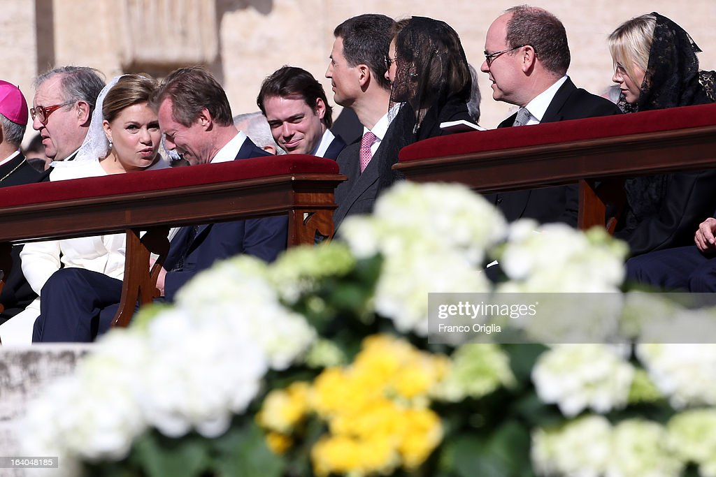 Duchess Maria Teresa of Luxembourg (2L), Grand Duke Henri of Luxembourg (3L) and their son Prince Felix (4L), Prince Albert II of Monaco (2R) and Princess Charlene of Monaco (R) attend the Inauguration Mass of Pope Francis in St. Peter's Square on March 19, 2013 in Vatican City, Vatican. The inauguration of Pope Francis is being held in front of an expected crowd of up to one million pilgrims and faithful who have crowded into St Peter's Square and the surrounding streets to see the former Cardinal of Buenos Aires officially take up his position. Pope Francis' inauguration takes place in front his cardinals, spiritual leaders as well as heads of states from around the world and he will now lead an estimated 1.3 billion Catholics.