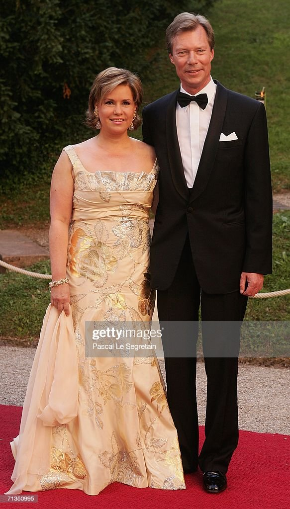 Duchess Maria Teresa of Luxembourg, Grand Duke Henri of Luxembourg pose as they arrive to attend a royal dinner that is part of the Grand Duke Henri of Luxembourg's silver wedding aniversary celebrations at The Berg Castle on July 1, 2006 in Luxembourg.