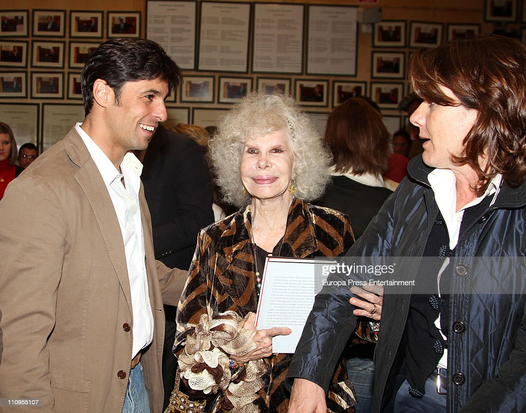 Duchess of Alba, <a gi-track='captionPersonalityLinkClicked' href=/galleries/search?phrase=Cayetana+Fitz-James+Stuart&family=editorial&specificpeople=6090682 ng-click='$event.stopPropagation()'>Cayetana Fitz-James Stuart</a> (C) and Francisco Rivera (L) attend the release of the book 'De Rivera a Ordonez', written by Julian Contreras Jr, at Antares Foundation on March 22, 2011 in Seville, Spain.