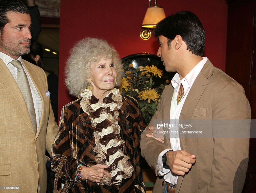 Duchess of Alba, <a gi-track='captionPersonalityLinkClicked' href=/galleries/search?phrase=Cayetana+Fitz-James+Stuart&family=editorial&specificpeople=6090682 ng-click='$event.stopPropagation()'>Cayetana Fitz-James Stuart</a> (C) and Francisco Rivera (R) attend the release of the book 'De Rivera a Ordonez', written by Julian Contreras Jr, at Antares Foundation on March 22, 2011 in Seville, Spain.