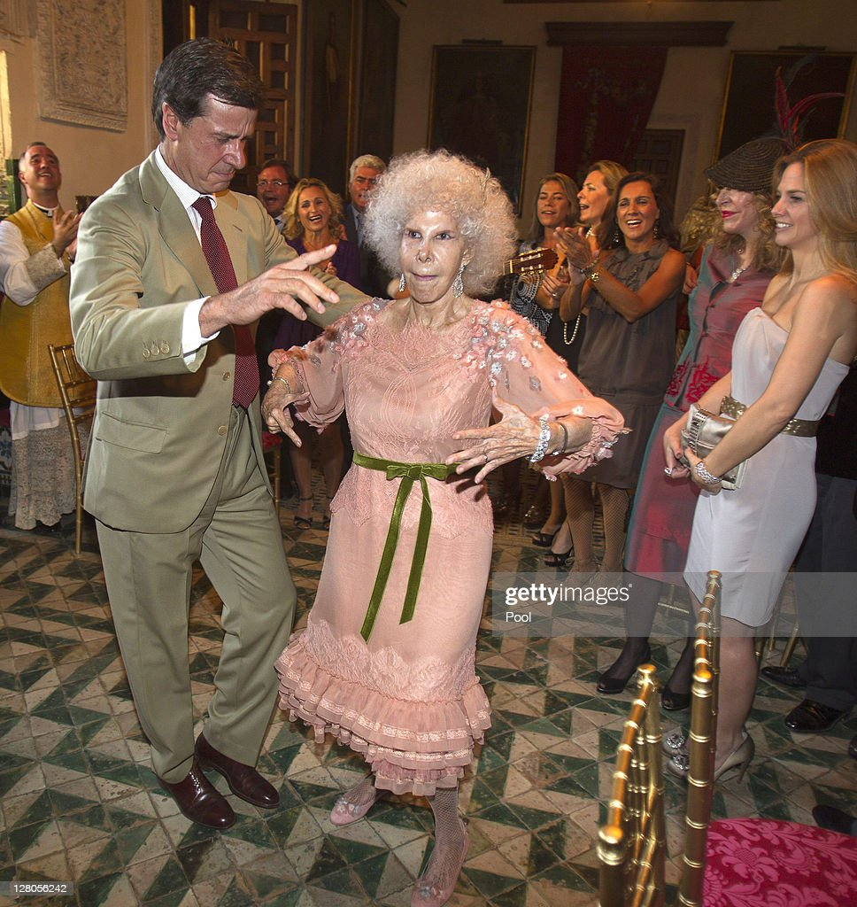 Duchess of Alba, Maria del Rosario Cayetana Fitz-James-Stuart dances with son <a gi-track='captionPersonalityLinkClicked' href=/galleries/search?phrase=Cayetano+Martinez+de+Irujo&family=editorial&specificpeople=3948682 ng-click='$event.stopPropagation()'>Cayetano Martinez de Irujo</a> during her wedding ceremony to Alfonso Diez Carabantes held at Duenas Palace on October 5, 2011 in Seville, Spain.