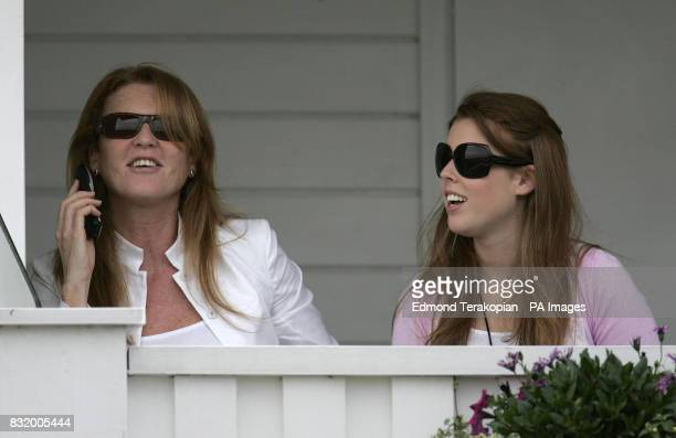 Duchess of York and her daughter Princess Beatrice watch the Queen's Cup Final at the Guards Polo Club Windsor Great Park