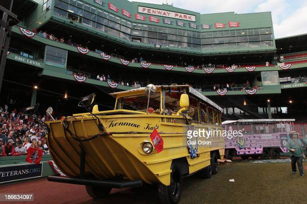 Duck boats assemble at Fenway Park before the World Series victory parade for the Boston Red Sox on November 2 2013 in Boston Massachusetts