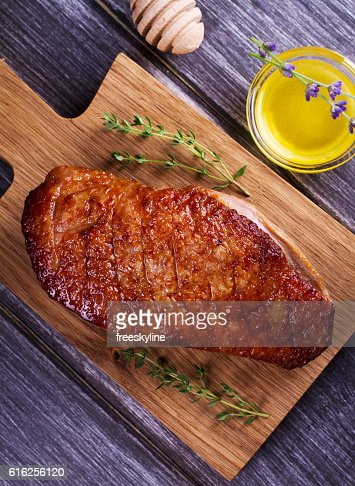 Duck breast, lavender honey and thyme : Stock Photo