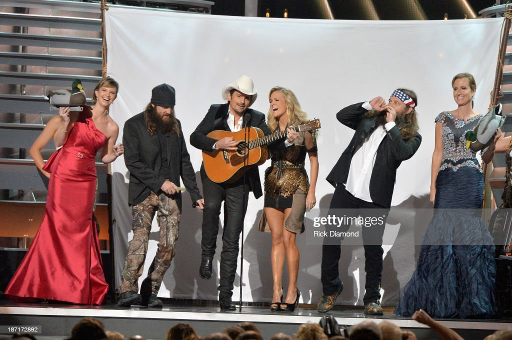 'Duck Dynasty' performs onstage with Hosts <a gi-track='captionPersonalityLinkClicked' href=/galleries/search?phrase=Brad+Paisley&family=editorial&specificpeople=206616 ng-click='$event.stopPropagation()'>Brad Paisley</a> and <a gi-track='captionPersonalityLinkClicked' href=/galleries/search?phrase=Carrie+Underwood&family=editorial&specificpeople=204483 ng-click='$event.stopPropagation()'>Carrie Underwood</a> during the 47th annual CMA Awards at the Bridgestone Arena on November 6, 2013 in Nashville, Tennessee.