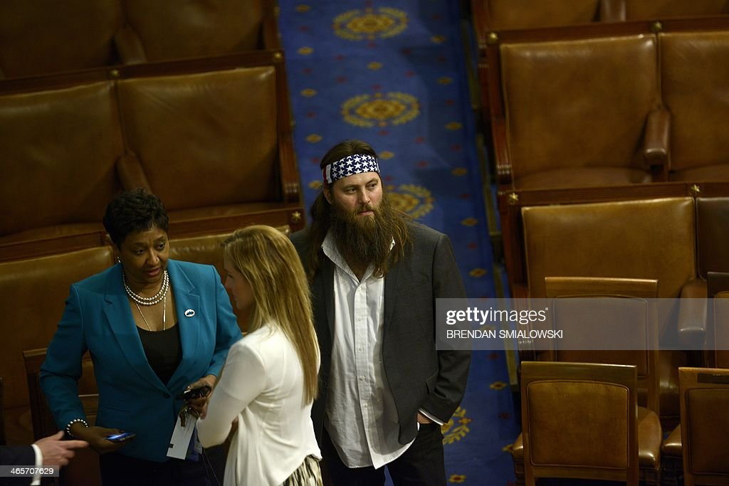 Duck Dynasty star Willie Robertson walks on the House floor after US President Barack Obama delivered the State of the Union address before a joint session of Congress on January 28, 2014 at the US Capitol in Washington. AFP PHOTO/Brendan SMIALOWSKI