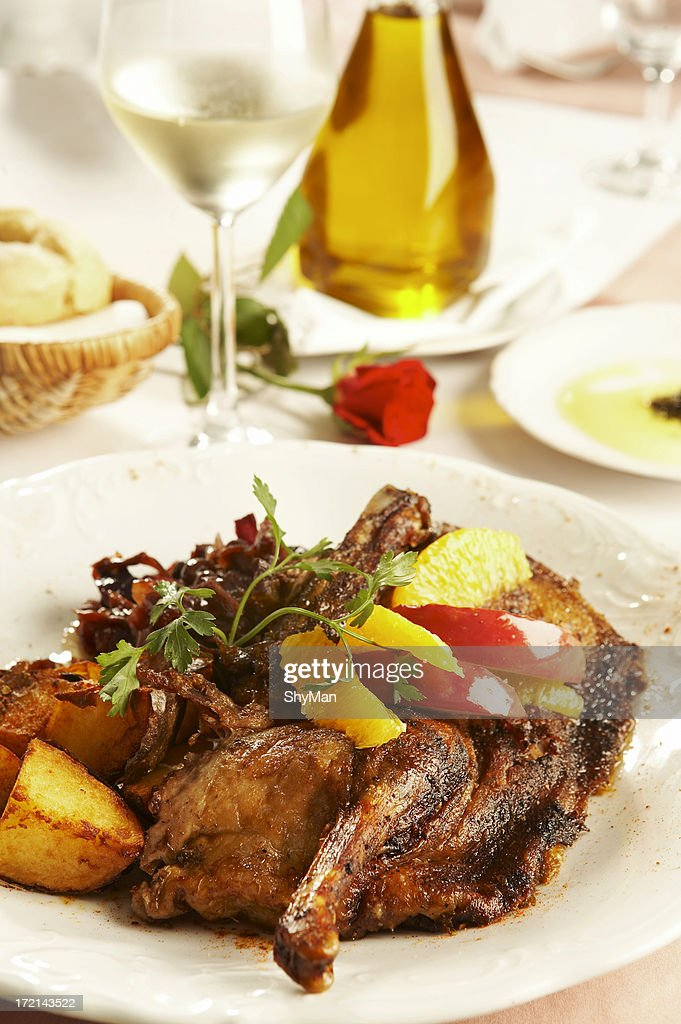 Duck meat with apples and oranges