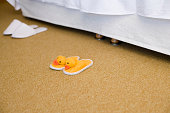 Duck slippers by bed