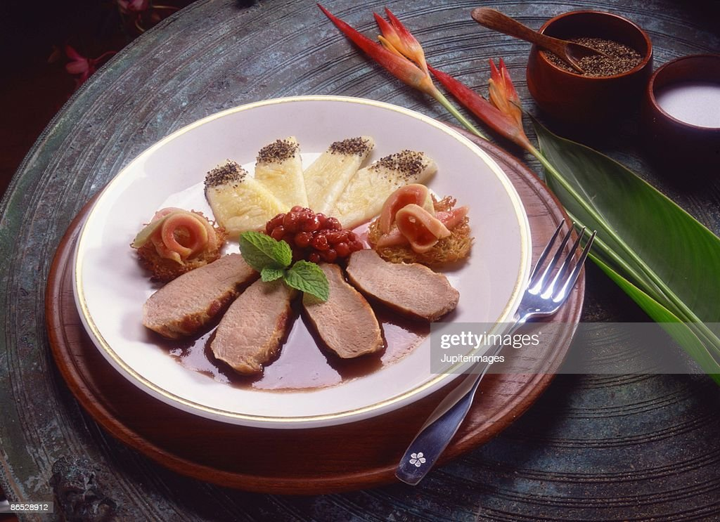 Duck with loganberries and pineapple dish : Stock Photo