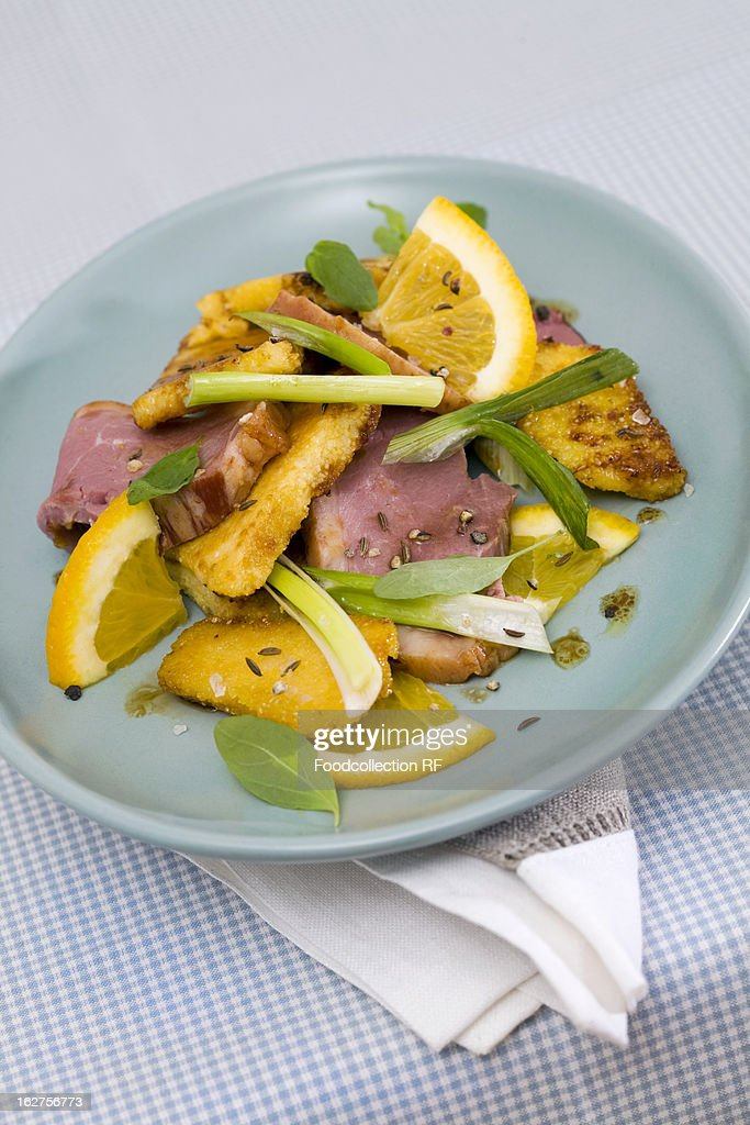 Duck with orange and fried polenta : Stock Photo