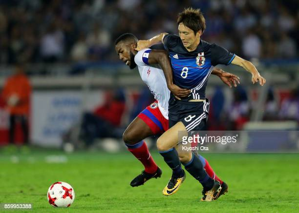 Duckens Nazon of Haiti and Genki Haraguchi of Japan during the international friendly match between Japan and Haiti at Nissan Stadium on October 10...