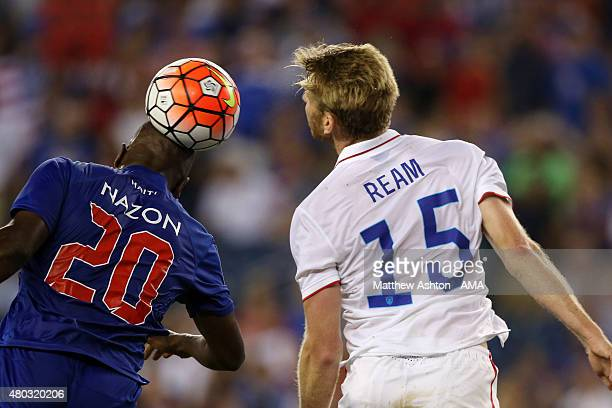 Duckens Nazon of Haiti and Tim Ream of United States head the ball during the CONCACAF Gold Cup match between USA and Haiti at Gillette Stadium on...