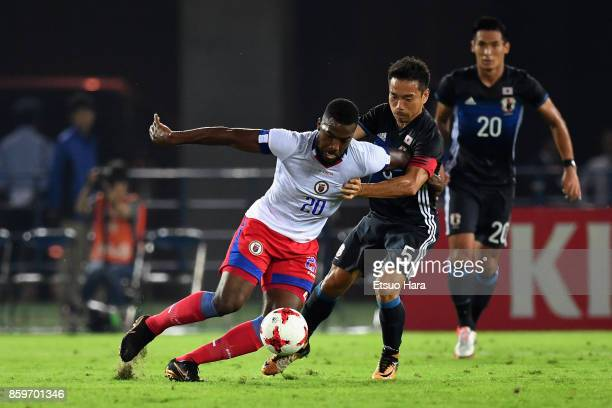 Duckens Nazon of Haiti and Yuto Nagatomo of Japan compete for the ball during the international friendly match between Japan and Haiti at Nissan...