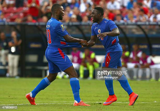 Duckens Nazon of Haiti reacts with Jeff Louis of Haiti after scoring against Panama during the 2015 CONCACAF Gold Cup Group A match between Panama...