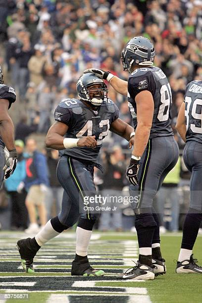 J Duckett of the Seattle Seahawks celebates with Will Heller during the game against the Arizona Cardinals on November 16 2008 at Qwest Field in...