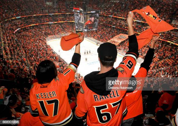 Ducks fans wave their towels during the national anthem prior to Game One of the Western Conference First Round between the Anaheim Ducks and the...