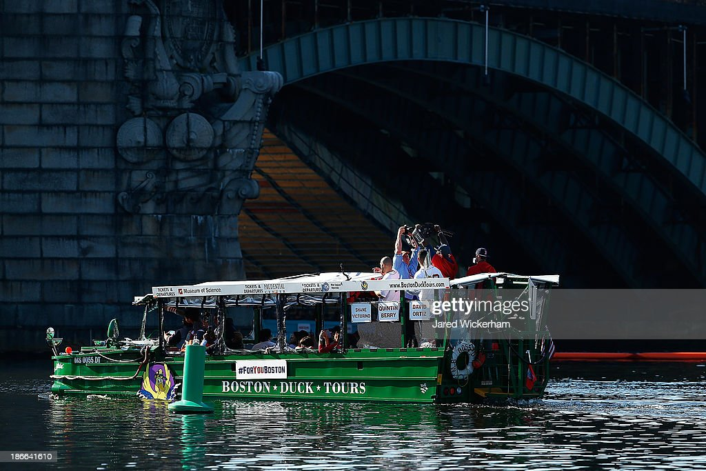 Ducky boats carrying members of the Boston Red Sox make their way down the Charles River during the World Series victory parade on November 2, 2013 in Boston, Massachusetts.