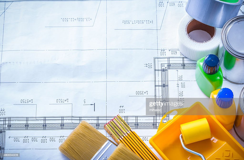 Duct tape wooden meter and paint tools on construction drawing : Stockfoto
