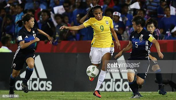 Duda of Brazil breaks through the Japan defence during the FIFA U20 Women's World Cup Papua New Guinea 2016 Quarter Final match between Japan and...