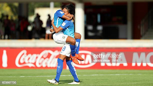 Duda of Brazil congratulates Gabi Nunes after she scored against Korea DPR during the first half of their Group A match of the FIFA U20 Women's World...
