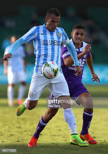Duda of Malaga controls the ball against Diogo Ferreira of the Glory during the International Club friendly match between Malaga CF and Perth Glory...